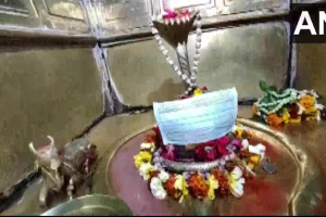 Priest covers idols in the temple with masks amid Coronavirus scare